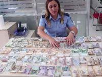Döviz bürosu gibi dilenci: Üzerinden 15 farklı birimde para çıktı
