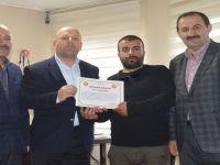 Gazeteci Özkan'a teşekkür belgesi verildi